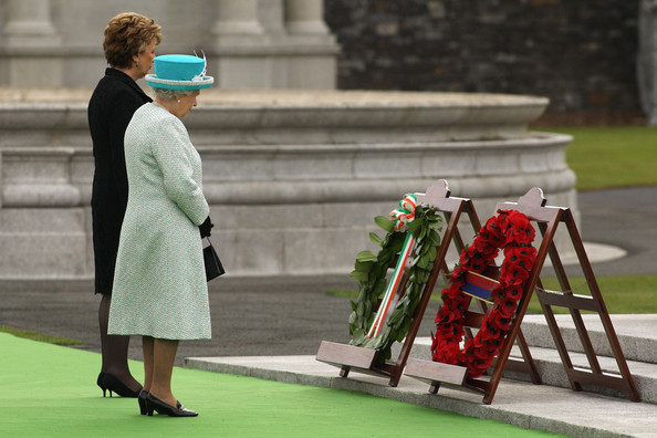 Queen Elizabeth II Queen Elizabeth II (R) and the Irish President Mary McAleese observe a minute's silence after laying wreaths at the Irish War Memorial Garden in Islandbridge on May 18, 2011 in Dublin, Ireland. The Duke and Queen's visit to Ireland is the first by a British monarch since 1911. An unprecedented security operation is taking place with much of the centre of Dublin turning into a car-free zone. Republican dissident groups have made it clear they are intent on disrupting proceedings.