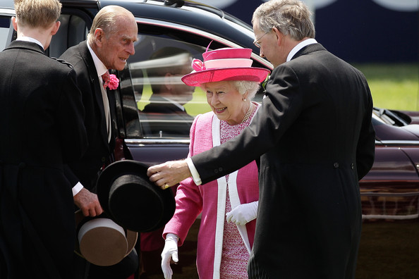 Queen Elizabeth II Queen Elizabeth II and Prince Philip, the Duke of Edinburgh arrive at Epsom Downs Racecourse to watch the Derby Day horse racing on June 4, 2011 in Epsom, England. The Queen's horse Carlton House is the bookmakers favourite to win the Derby race.