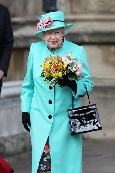 The Royal Family Attend Easter Day Service in Windsor [the royal family,flower,tradition,fashion,headgear,suit,flower bouquet,outerwear,gentleman,costume,flower arranging,elizabeth ii,service,service,flower,monarchy,windsor,st georges chapel,windsor castle,queen regnant,elizabeth ii,queen regnant,monarchy,queen consort,st georges chapel windsor castle,wedding of prince william and catherine middleton,english language,glamour.ru]