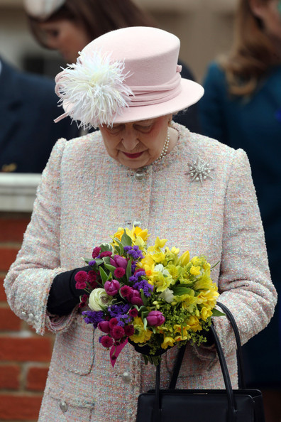 The Royal Family Attend The Easter Matins Service At Windsor Castle [the royal family,flower arranging,floristry,bouquet,floral design,flower,yellow,plant,cut flowers,headgear,art,elizabeth ii,children,service,flowers,windsor castle,grounds,england,easter matins service,easter day]
