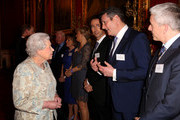Queen Elizabeth II meets singer Tony Hadley, Vice President of Shooting Star Chase during her reception to celebrate the patronages & affiliations of the Earl and Countess of Wessex at Buckingham Palace on February 10, 2015 in London, England