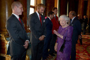 Queen Elizabeth II speaks with England Rugby Union head coach Stuart Lancaster (left) and England captain Chris Robshaw (second left) during a reception to mark the Rugby World Cup 2015 at Buckingham Palace on October 12, 2015 in London, United Kingdom.