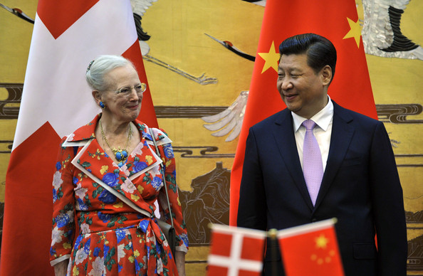 Chinese President Xi Jinping (R) and Queen Margrethe II of Denmark smile during a signing ceremony between China and Denmark at the Great Hall of the People on April 24, 2014 in Beijing, China.  Queen Margrethe II and Prince Henrik of Denmark are on a vist to China from April 24 to 28  (Photo by Parker Song-Pool/Getty Images).