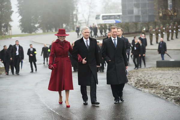 King Philippe Of Belgium And Queen Mathilde Attend The 75th Battle Of The Bulge Anniversary Remembrance Ceremony In Bastogne [battle of the bulge,fashion,standing,suit,event,uniform,formal wear,walking,white-collar worker,tourism,philippe of belgium,mathilde,henri grand duke of luxembourg,anniversary remembrance ceremony in bastogne,l-r,belgium,bastogne,remembrance ceremony]