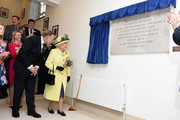 Queen Elizabeth II unveils a plaque after meeting members of Goodenough College during a visit on December 1, 2016 in London, England. Goodenough College is the leading residential community for British and international postgraduate students studying in London.