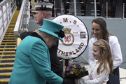 Queen Elizabeth II is given some flowers as she visits HMS Sutherland in the West India Dock as the ship celebrates its 20th anniversary of her Commissioning on October 23, 2017 in London, England.