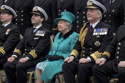 Queen Elizabeth II joins the Ship's Company on the Flight Deck for a group photograph as she visits HMS Sutherland in the West India Dock as the ship celebrates its 20th anniversary of her Commissioning on October 23, 2017 in London, England.