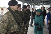 Queen Elizabeth II meets with personnel on the upper deck as she visits HMS Sutherland in the West India Dock as the ship celebrates its 20th anniversary of her Commissioning on October 23, 2017 in London, England.
