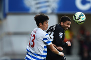 Aaron Lennon of Everton wins a header from Suk-Young Yun of QPR during the Barclays Premier League match between Queens Park Rangers and Everton at Loftus Road on March 22, 2015 in London, England.
