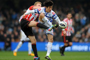 Sebastian Larsson of Sunderland and Ji-Sung Park of Queens Park Rangers battle for the ball during the Barclays Premier League match between Queens Park Rangers and Sunderland at Loftus Road on March 9, 2013 in London, England.