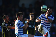 Sandro (R) and Yoon Suk-Young of QPR clear the ball from Andros Townsend of Spurs during the Barclays Premier League match between Queens Park Rangers and Tottenham Hotspur at Loftus Road on March 7, 2015 in London, England.