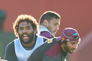 Johnathan Thurston is tackled by Sam Thaiday during a Queensland Maroons State of Origin team training session at Punt Road Oval on June 11, 2015 in Melbourne, Australia.