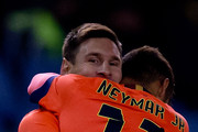 Lionel Messi (L) of FC Barcelona celebrates scoring their second goal embraced with teammate Neymar JR. (R) during the La Liga match between RC Deportivo La Coruna and FC Barcelona at Riazor Stadium on January 18, 2015 in La Coruna, Spain.