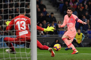 Lionel Messi of Barcelona shoots during the La Liga match between RCD Espanyol and FC Barcelona at RCDE Stadium on December 8, 2018 in Barcelona, Spain.