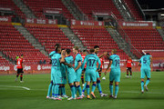 Arturo Vidal of FC Barcelona celebrates with teammates after scoring his sides first goal during the La Liga match between RCD Mallorca and FC Barcelona at Estadio de Son Moix on June 13, 2020 in Mallorca, Spain.