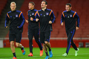 Olivier Deschacht (L) and Sacha Kljestan (2R) jog with team mates during an RSC Anderlecht training session ahead of the UEFA Champions League match against Arsenal at Emirates Stadium on November 3, 2014 in London, United Kingdom.