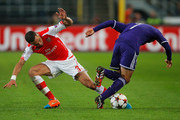 Alexis Sanchez of Arsenal tackles Andy Najar of Anderlecht during the UEFA Champions League Group D match between RSC Anderlecht and Arsenal at Constant Vanden Stock Stadium on October 22, 2014 in Brussels, Belgium.