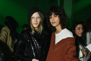 Models Julia Nobis (L) and Mica Arganaraz attend the Raf Simons runway show during New York Fashion Week Mens' on February 7, 2018 in New York City.