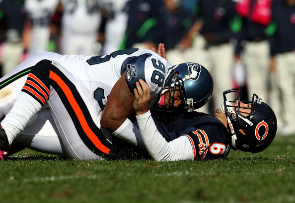 Raheem Brock Jay Cutler #6 of the Chicago Bears is driven to the ground after throwing by Raheem Brock #98 of the Seattle Seahawks at Soldier Field on October 17, 2010 in Chicago, Illinois. The Seahawks defeated the Bears 23-20.