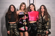 Designers Vanessa Sason and Raisa Sason pose with Madison Reed and Victoria Justice (C) backstage for Raisavanessa during New York Fashion Week: The Shows at Gallery I at Spring Studios on February 12, 2020 in New York City.