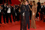 """(L-R) Jennifer Flavin, Sylvester Stallone and Sistine Rose Stallone attend the screening of """"Rambo - First Blood"""" during the 72nd annual Cannes Film Festival on May 24, 2019 in Cannes, France."""
