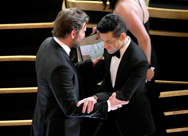 91st Annual Academy Awards - Show [event,interaction,suit,gesture,conversation,sport venue,white-collar worker,performance,bradley cooper,rami malek,academy awards,hollywood,california,dolby theatre,show,annual academy awards]