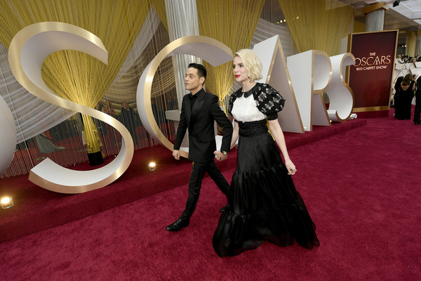 92nd Annual Academy Awards - Red Carpet [red carpet,fashion,red carpet,carpet,flooring,dress,formal wear,event,gown,haute couture,interior design,rami malek,lucy boynton,hollywood,california,highland,92nd annual academy awards,rami malek,lucy boynton,bohemian rhapsody,hollywood highland,academy awards,rocketman,photograph,academy award for best actor,red carpet]