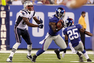 Randy Moss Antrel Rolle New England Patriots v New York Giants