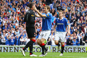 Allan McGregor (L) of Rangers celebrates with team mate Sasa Papac (C) after saving a penalty from Georgios Samaras of Celtic during the Clydesdale Bank Premier League match between Rangers and Celtic at Ibrox Stadium on April 24, 2011 in Glasgow, Scotland.