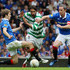 Sasa Papac (L) and David Wier of Rangers tackle Georgios Samaras (C) of Celtic during the Clydesdale Bank Premier League match between Rangers and Celtic at Ibrox Stadium salutes his supporters  on April 24, 2011 in Glasgow, Scotland.