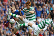 Steven Naismith of Rangers tackles Ki Sung- Yueng and Beram Kayal of Celtic during the Clydesdale Bank Premier League match between Rangers and Celtic at Ibrox Stadium on April 24, 2011 in Glasgow, Scotland.