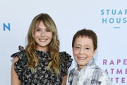 Elizabeth Olsen (L) and Gail Abarbanel arrive at The Rape Foundation's 2019 Annual Brunch Benefiting Rape Treatment Center and Stuart House at Santa Monica-UCLA Medical Center on October 06, 2019 in Beverly Hills, California.