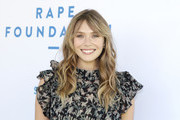 Elizabeth Olsen attends the Rape Foundation Annual Brunch 2019 at Greenacres, The Private Estate of Ron Burkle on October 06, 2019 in Beverly Hills, California.