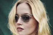 In this handout image supplied by Ray-Ban, Ellie Bamber wearing Ray-Ban poses at the Ray-Ban Studios during All Points East Festival at Victoria Park on May 26, 2019 in London, England.