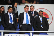 QPR Chief Executive Philip Beard (C) and Tony Fernandes (R), owner of QPR look on prior to the Barclays Premier League match between Reading and Queens Park Rangers at the Madejski Stadium on April 28, 2013 in Reading, England.