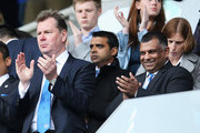QPR Chief Executive Philip Beard (L) and Tony Fernandes (R), owner of QPR applaud prior to the Barclays Premier League match between Reading and Queens Park Rangers at the Madejski Stadium on April 28, 2013 in Reading, England.