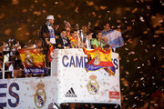 (L-R) Real Madrid players Sergio Ramos, Cristiano Ronaldo, Pepe, Bale, Jesus Fernandez and Angel Di Maria arrive on a bus to celebrate their victory In the UEFA Champions League Final match against Club Atletico de Madrid at Cibeles Square on May, 24, 2014 in Madrid, Spain. Real Madrid CF has achieved their 10th European Cup at Lisbon, 12 years after their last one.