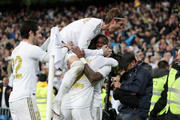 Vinicius Junior of Real Madrid celebrates with teammates Daniel Carvajal, Isco and Sergio Ramos of Real Madrid after scoring his team's first goal during the Liga match between Real Madrid CF and FC Barcelona at Estadio Santiago Bernabeu on March 01, 2020 in Madrid, Spain.