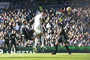 Cristiano Ronaldo of Real Madrid CF scores their second goal during the La Liga match between Real Madrid CF and Granada CF at Estadio Santiago Bernabeu on January 7, 2017 in Madrid, Spain.