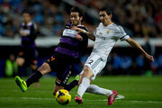 Angel Di Maria (R) of Real Madrid CF competes for the ball with Marc Valiente (L) of Real Valladolid CF during the La Liga match between Real Madrid CF and Real Valladolid CF at Estadio Santiago Bernabeu on November 30, 2013 in Madrid, Spain.