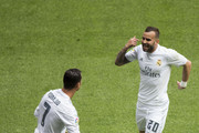 Cristiano Ronaldo (L) of Real Madrid CF celebrates scoring their third goal with teammate Jese Rodriguez (R) during the La Liga match between Real Madrid CF and SD Eibar at Estadio Santiago Bernabeu on April 9, 2016 in Madrid, Spain.