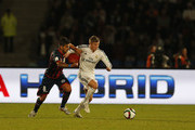 Toni Kroos of Real Madrid CF holds off Enzo Kalinski of San Lorenzo during the FIFA Club World Cup Final match between Real Madrid CF and San Lorenzo at Le Grand Stade de Marrakech on December 20, 2014 in Marrakech, Morocco.