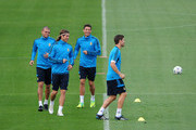 Cristiano Ronaldo (2nd R) of Real Madrid smiles as he runs with his teammates Pepe (L), Sergio Ramos and Xabi Alonso during a training session ahead of their UEFA Champions League group D match against Lyon at the Valdebebas training ground on October 17, 2011 in Madrid, Spain.