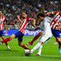 Gabi Juanfran Photos - Marcelo of Real Madrid crosses the ball under pressure from Gabi and Juanfran of Club Atletico de Madrid during the UEFA Champions League Final between Real Madrid and Atletico de Madrid at Estadio da Luz on May 24, 2014 in Lisbon, Portugal. - Real Madrid v Atletico de Madrid - UEFA Champions League Final