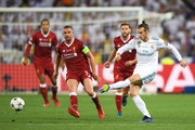 Jordan Henderson and Adam Lallana of Liverpool put pressure on Gareth Bale of Real Madrid during the UEFA Champions League Final between Real Madrid and Liverpool at NSC Olimpiyskiy Stadium on May 26, 2018 in Kiev, Ukraine.