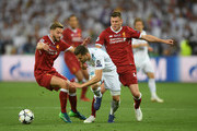 Nacho Fernandez of Real Madrid, James Milner and Adam Lallana of Liverpool compete for the ball during the UEFA Champions League Final between Real Madrid and Liverpool at NSC Olimpiyskiy Stadium on May 26, 2018 in Kiev, Ukraine.