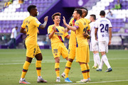 Arturo Vidal of Barcelona (obscured) celebrates with teammates after scoring his team's first goal during the Liga match between Real Valladolid CF and FC Barcelona at Jose Zorrilla on July 11, 2020 in Valladolid, Spain. Football Stadiums around Europe remain empty due to the Coronavirus Pandemic as Government social distancing laws prohibit fans inside venues resulting in all fixtures being played behind closed doors.