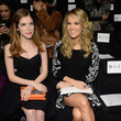 She sits in the front row at Fashion Week with Anna Kendrick.