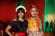 Wanda Badwal and Lexy Hell attend the Lena Hoschek show during the Mercedes-Benz Fashion Week Spring/Summer 2015 at Erika Hess Eisstadion on July 8, 2014 in Berlin, Germany.