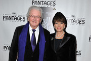 Lyricist Leslie Bricusse (L) and wife actress Yvonne Roman arrive at the opening night of 'Jekyll & Hyde' held at the Pantages Theatre on February 12, 2013 in Hollywood, California.